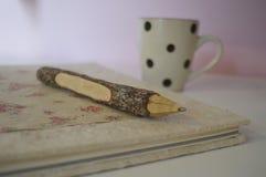 Σημειωματάριο και καφές Στοκ εικόνα με δικαίωμα ελεύθερης χρήσης