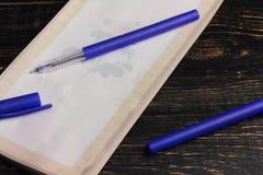 Σημειωματάριο και πέννα Στοκ Φωτογραφίες