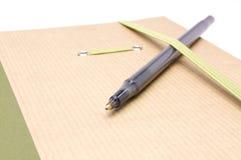 Σημειωματάριο με μια μάνδρα για τις σημειώσεις Στοκ Εικόνες