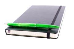 Σημειωματάριο με την πέννα Στοκ φωτογραφία με δικαίωμα ελεύθερης χρήσης