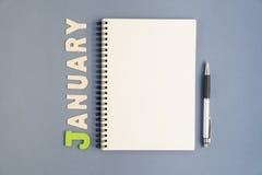 Σημειωματάριο με τη μάνδρα και το κείμενο Ιανουαρίου Στοκ εικόνες με δικαίωμα ελεύθερης χρήσης