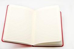 Σημειωματάριο στην άσπρη ανασκόπηση Στοκ Εικόνα