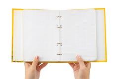 σημειωματάριο χεριών που Στοκ φωτογραφία με δικαίωμα ελεύθερης χρήσης