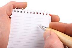 σημειωματάριο 2 χεριών Στοκ Φωτογραφία