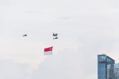 Σιγκαπούρη 18 Ιουλίου, 2015: μύγα ελικοπτέρων στον ουρανό για πεντηκοστή ANN Στοκ Φωτογραφία