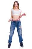 σιτηρέσιο Ικανότητα Νέο κορίτσι στο μεγάλο μέγεθος τζιν παντελόνι σε ένα άσπρο υπόβαθρο Στοκ φωτογραφίες με δικαίωμα ελεύθερης χρήσης