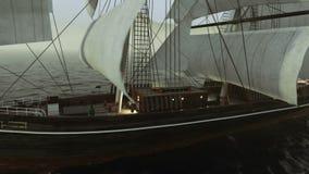 Σκάφος που πλέει στις τραχιές θάλασσες κοντά επάνω στο υπόβαθρο ηλιοβασιλέματος απεικόνιση αποθεμάτων