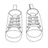 Σκίτσο των πάνινων παπουτσιών για ένα μωρό Ένα ζευγάρι των παπουτσιών που απομονώνεται σε ένα άσπρο υπόβαθρο επίσης corel σύρετε  στοκ εικόνες