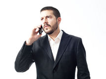 Σκεπτόμενος νέος επιχειρηματίας στο τηλέφωνο Στοκ Εικόνα