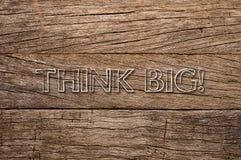 Σκεφτείτε μεγάλο γραπτό στο ξύλινο υπόβαθρο Στοκ Φωτογραφία