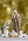 Σκηνή Nativity στο χρυσό υπόβαθρο με το διάστημα αντιγράφων Στοκ Εικόνες