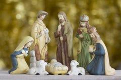 Σκηνή Nativity στο χρυσό υπόβαθρο Στοκ Εικόνα