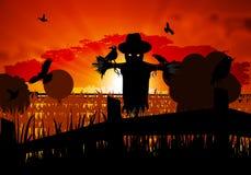 Σκιάχτρο φθινοπώρου που φρουρεί τον τομέα από τους κόρακες αποκριές Στοκ εικόνα με δικαίωμα ελεύθερης χρήσης