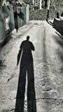 Σκιά ενός ατόμου που έρχεται κατ' οίκον Στοκ εικόνες με δικαίωμα ελεύθερης χρήσης