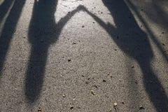 Σκιά των χεριών λαβής γυναικών Στοκ Εικόνες