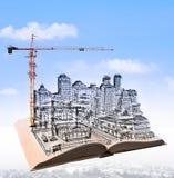 Σκιαγράφηση της οικοδόμησης κτηρίου στο πετώντας βιβλίο άνω του αστικού SCE Στοκ Φωτογραφία