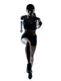 Σκιαγραφία άλματος δρομέων γυναικών jogger στοκ εικόνα με δικαίωμα ελεύθερης χρήσης