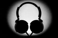 Σκιαγραφία ακουστικών Στοκ Φωτογραφία