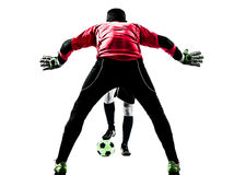 Σκιαγραφία ανταγωνισμού τερματοφυλακάων ποδοσφαιριστών δύο ατόμων Στοκ εικόνα με δικαίωμα ελεύθερης χρήσης