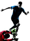 Σκιαγραφία ανταγωνισμού τερματοφυλακάων ποδοσφαιριστών δύο ατόμων Στοκ Εικόνα