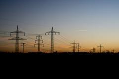 Σκιαγραφία 3 αυγής ανατολής ηλιοβασιλέματος τοπίων πύργων χάλυβα γραμμών ηλεκτρικής δύναμης Στοκ εικόνες με δικαίωμα ελεύθερης χρήσης