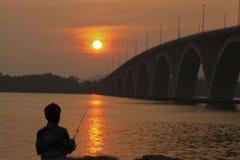 Σκιαγραφία ενός ψαρά Στοκ Εικόνες