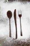 Σκιαγραφία εργαλείων στη σκόνη ζάχαρης Στοκ Εικόνες