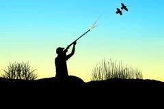 Σκιαγραφία κυνηγών Στοκ Εικόνες
