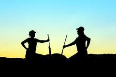 Σκιαγραφία κυνηγών Στοκ Φωτογραφίες