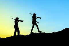 Σκιαγραφία κυνηγών Στοκ Εικόνα