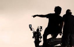 Σκιαγραφία πίσω από τις σκηνές του ατόμου καμερών Στοκ εικόνα με δικαίωμα ελεύθερης χρήσης