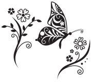 Σκιαγραφία πεταλούδων και κλάδος λουλουδιών Στοκ Εικόνες