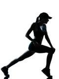 Σκιαγραφία προθέρμανσης τεντώματος δρομέων γυναικών jogger στοκ φωτογραφία με δικαίωμα ελεύθερης χρήσης