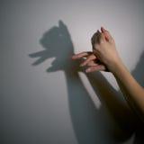 σκιαγραφία σκιών κουταβιών Στοκ Φωτογραφία