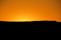 Σκιαγραφία στο φως ηλιοβασιλέματος Στοκ Φωτογραφία