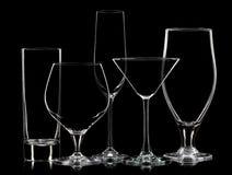 Σκιαγραφία των διαφορετικών γυαλιών στο μαύρο υπόβαθρο Στοκ Φωτογραφία
