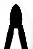 Σκιαγραφία των κλειστών πιό plier πενσών στο λευκό Στοκ φωτογραφία με δικαίωμα ελεύθερης χρήσης