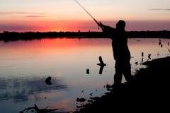 σκιαγραφία ψαράδων Στοκ εικόνες με δικαίωμα ελεύθερης χρήσης