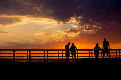 Σκιαγραφίες ηλιοβασιλέματος Στοκ Φωτογραφίες