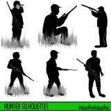 σκιαγραφίες κυνηγών Στοκ Εικόνες