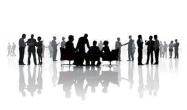 Σκιαγραφίες της διαφορετικής εργασίας επιχειρηματιών στοκ εικόνες
