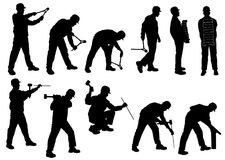 Σκιαγραφίες του ατόμου που λειτουργούν με τα τούβλα, πένσες, σφυρί, whipsaw στοκ φωτογραφία με δικαίωμα ελεύθερης χρήσης
