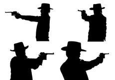 Σκιαγραφίες του κάουμποϋ με ένα πιστόλι στοκ εικόνα με δικαίωμα ελεύθερης χρήσης