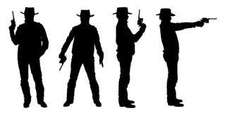 Σκιαγραφίες του κάουμποϋ με ένα πυροβόλο όπλο στοκ φωτογραφία με δικαίωμα ελεύθερης χρήσης