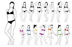 Σκιαγραφίες των όμορφων κοριτσιών που στέκονται στο χρωματισμένο φόρεμα μπικινιών Στοκ Εικόνες