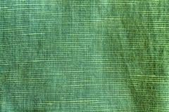 Σκιασμένη κομψή σύσταση κινηματογραφήσεων σε πρώτο πλάνο, υπόβαθρο λινού, επίπεδο επιφάνειας λιναριού, swatch υφάσματος Στοκ Εικόνα