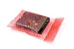 Σκληρός δίσκος στο περικάλυμμα φυσαλίδων για το προϊόν προστασίας που ραγίζεται ή ασφάλεια κατά τη διάρκεια της διέλευσης Στοκ Φωτογραφίες