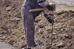 Σκληρός εργαζόμενος με την αλυσίδα και τη βαρειά σιδήρου Στοκ Εικόνες