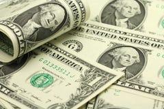 Σκορπισμένες σημειώσεις σε ένα αμερικανικό δολάριο Στοκ Εικόνα