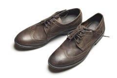 Σκοτεινά καφετιά παπούτσια δέρματος στο άσπρο υπόβαθρο Στοκ εικόνα με δικαίωμα ελεύθερης χρήσης